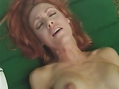 Redhead big boobs sucks cock oustide